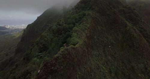 A Man Hiking The Koolau Mountain Range