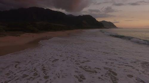 A Man Running On The Beach Shore