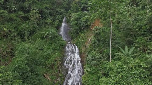 Drone Footage Of A Waterfalls Cascading Down The Mountain Forest