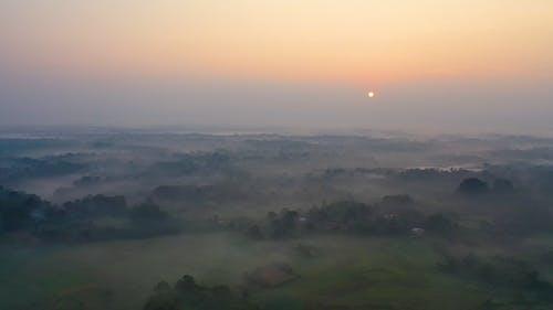 Sunrise Over a Fog Covered Land
