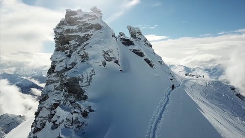 People Climbing The Mountains of NZ