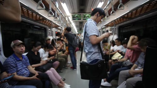 People Using The Train For Public Transportation