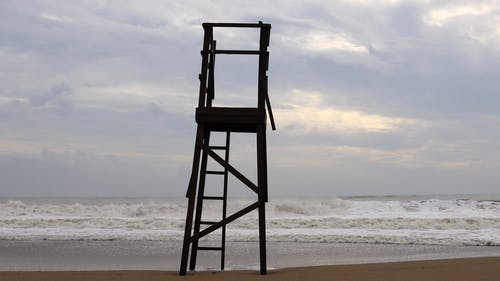 A Wooden Lifeguard Tower Overlooking The Open Sea