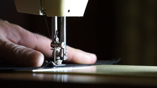 A Tailor Using A Sewing Machine
