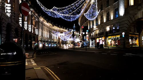 Christmas Lights Decorations Hanging Above The Stretch Of A London Street