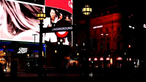 An Giant Electronic Billboards Lighting Up A Street In London