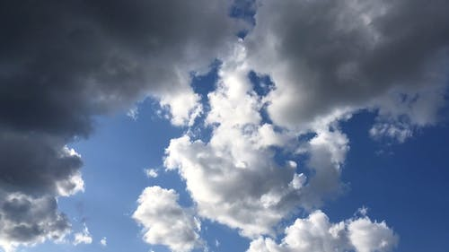 A Formation Of White Clouds Moving In The Wind Direction