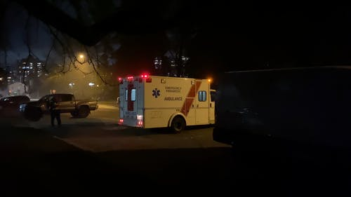 An Ambulance On A Parking Lot Responding To An Emergency