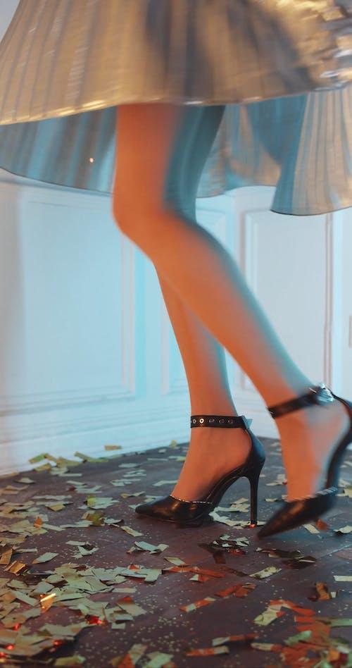 A Woman Dancing In Her High Heels