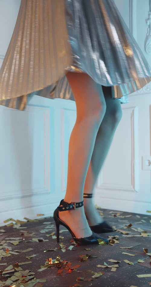 A Woman Feet In High Heels Doing  Repeated Turns