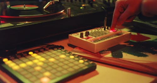 A Disc Jockey Playing Music With The Sound Equipment