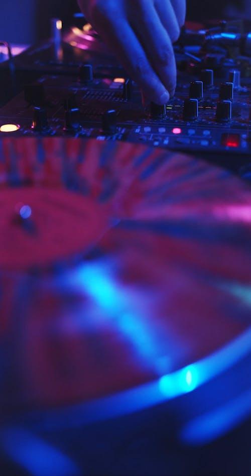 Disc Jockey Performing At A Disco
