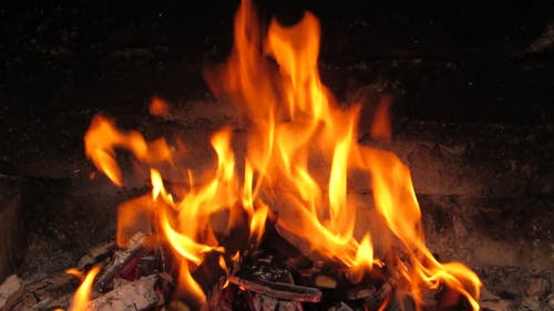 The Flame Of Burning Fire Woods In A Fireplace