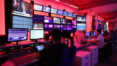 Men Working In The Control Room Of A Broadcasting Network Company