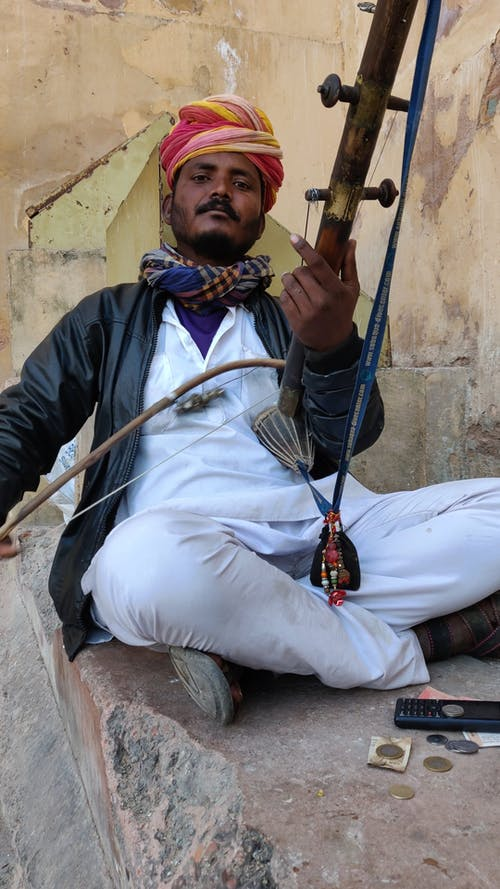 A Man Playing A Traditional Musical Instrument Of India