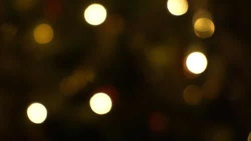 An out Of Focus Footage Of A Flashing Christmas Lights