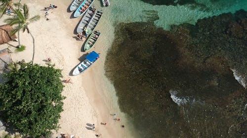 Wooden Boats Docked On The Seashore