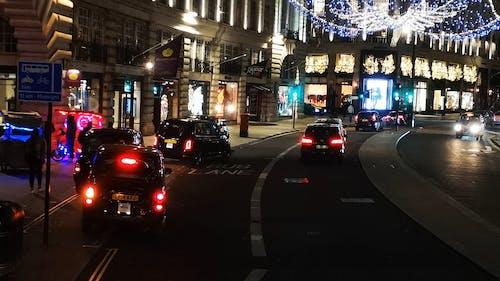 City Street With Illuminated Christmas Lights At Night