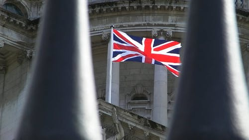 The Flag Of Great Britain Swaying With The Wind Blows