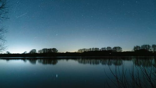 Timelapse Of Night Sky Over Lake