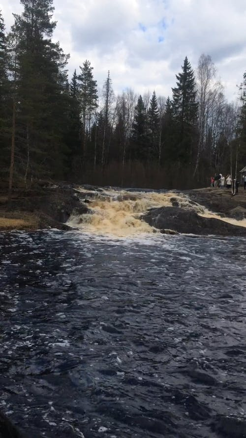 The Strong Current Of A River Flowing Down