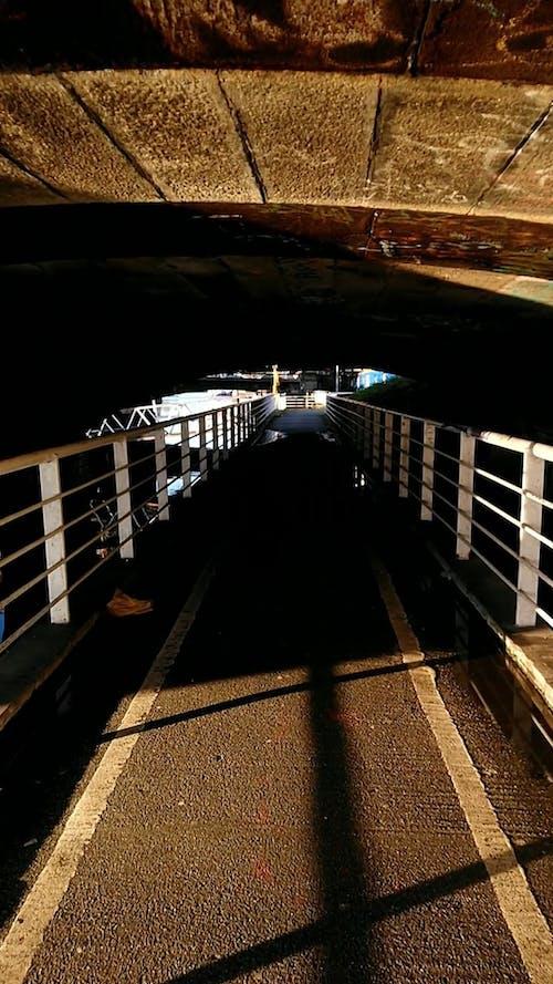 Crossing A Tunnel On A Footbridge