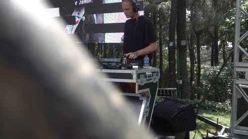 DJ Setting Up His Gears In Slow Moti