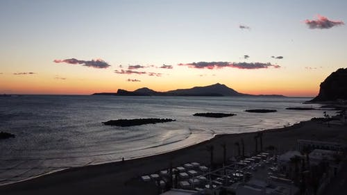 Drone Footage Of A Beach At Sunset
