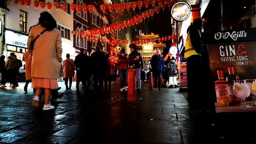 People Walking On A Busy Street In China Town Of London City