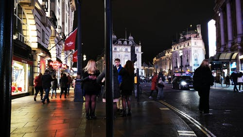 People Meeting And Walking On The Busy Side Walk Of London Streets