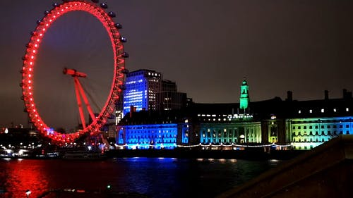 Lights Display On London eye And The Parliament Building