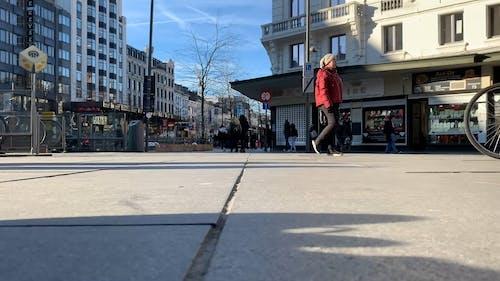 People Walking On A Busy Sidewalk In The Street Of Antwerp City