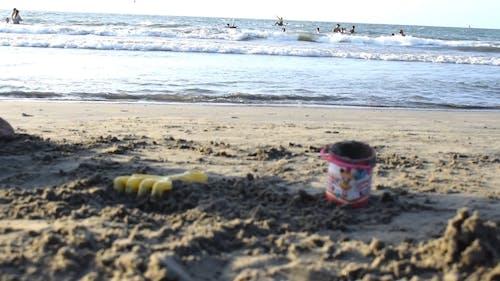 Toys For Sand Play Left Lying On The Beach Sand