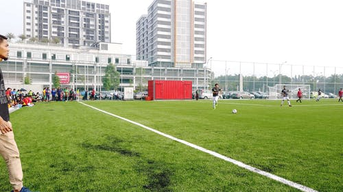 Footage Of The Soccer Field With People Playing