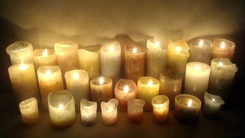 A Lighted Candles Giving Light To Darkness
