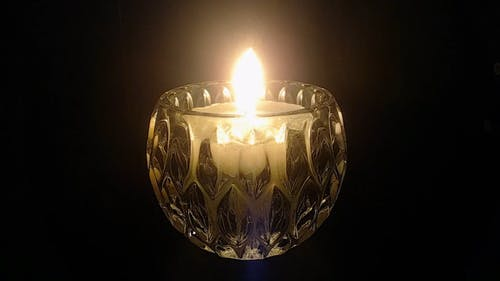 Close-up Footage Of A Burning Candle Giving Light In Darkness
