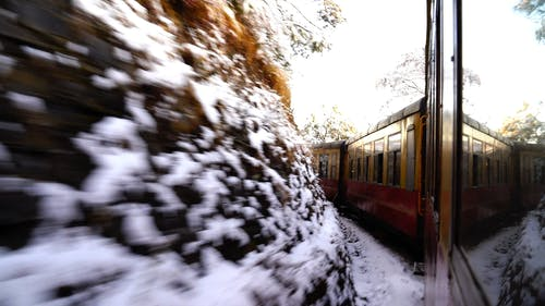 Train Traveling On The Mountainside In Winter