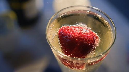A Strawberry Fruit Mixed In An Alcoholic Drink