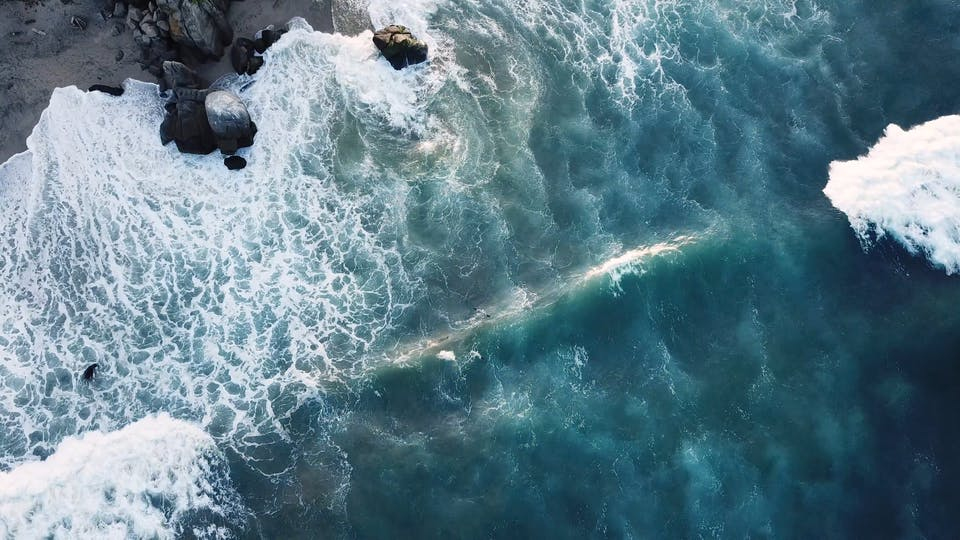 Drone View Of Big Waves Rushing To The Shore