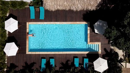 Top View Footage Of Someone Diving In The Pool