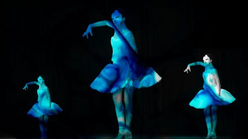 A Group Of Ballerina Wearing A Phantom Mask Staging A Live Performance