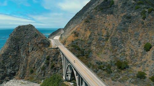 The Big Creek Bridge Connecting Highway One On The California Coastline