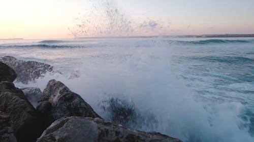 Waves Crashing The Rocks Formation On A Seashore