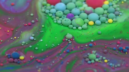 A Mixture Of Colorful Paint In Liquid