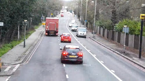 Footage Of A Traffic In The Street Taken By A Moving Vehicle