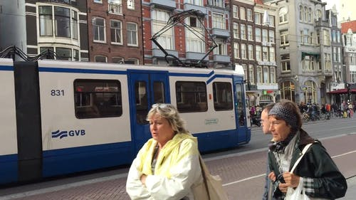 Electric Tram In Amsterdam Streets Used For Public Transportation