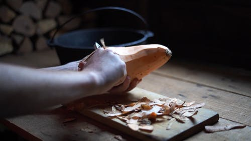 Peeling A Sweet Potato Using A Peeler