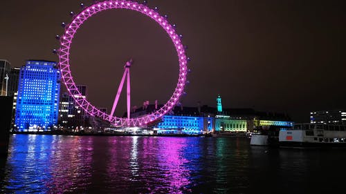 Colorful Lights Display On London Eye At Night
