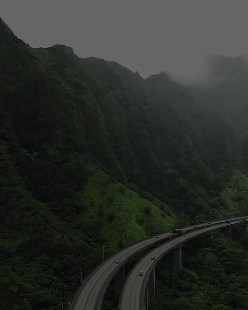 An Elevated Highway In The Mountain Valley In Hawaii