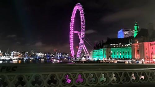 Lights Display On London Eye Observation Wheel Along The Bank Of Thames River